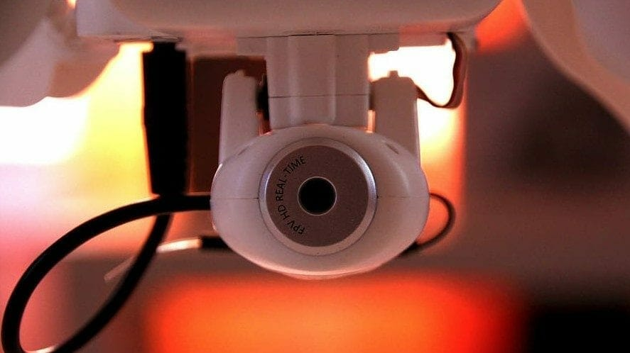 a camera installed within a house and partially hidden